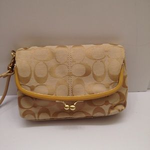 Coach yellow sig c kiss lock fold over wristlet